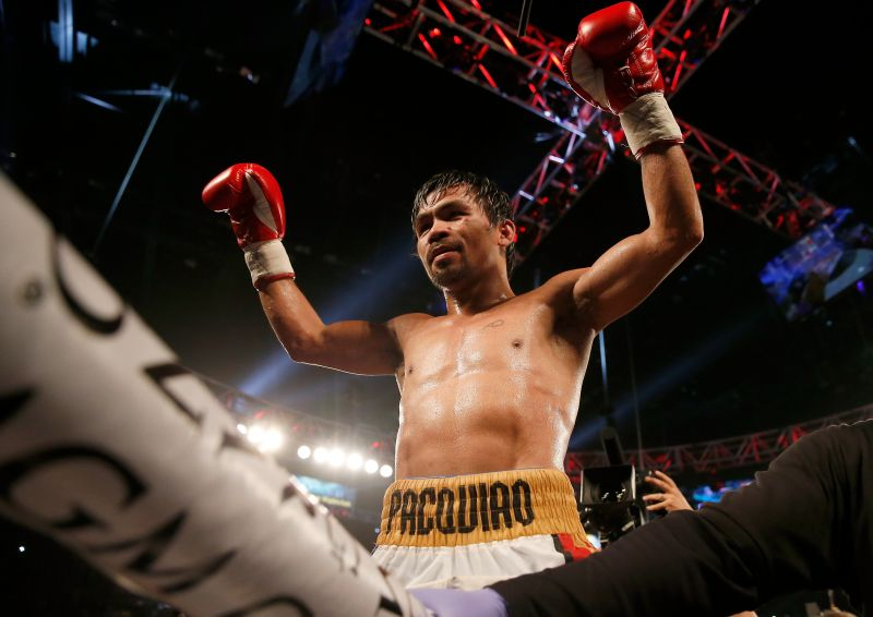 Manny Pacquiao with arms in the air during boxing match
