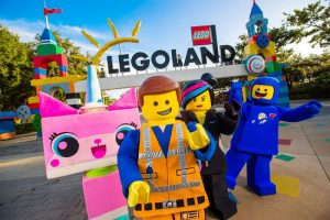 promotional picture showing lego characters outside of legoland entrance